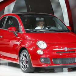 FILE - In this Nov. 17, 2010 file photo, the newly unveiled 2012 model of the Fiat 500, or Cinquecento, is seen at the LA Auto Show in Los Angeles. The stylish Italian subcompact isn't selling well, even though it looks cool and is fun to drive.