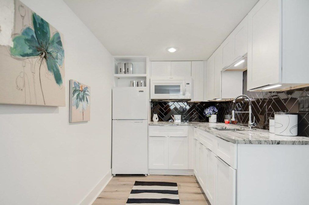 A long white and black kitchen space.
