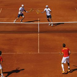 Mike Bryan of US, right, returns the ball beside his fellow teammate Bob Bryan, to Spain's Marcel Granollers and Marc Lopez, bottom left, during the doubles, the third match of the rubber, at their Davis Cup World Group Semi-final tennis match against Spain, in Gijon, northern Spain, Saturday, Sept. 15, 2012. The US Davis Cup double team won 3-6, 6-3, 5-7, 5-7.