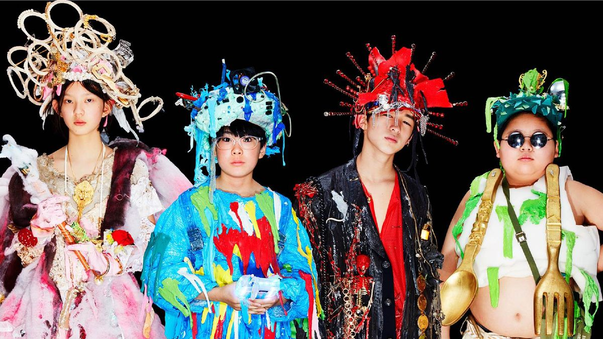 the cast of We Are Little Zombies in their extravagant Little Zombies band costumes
