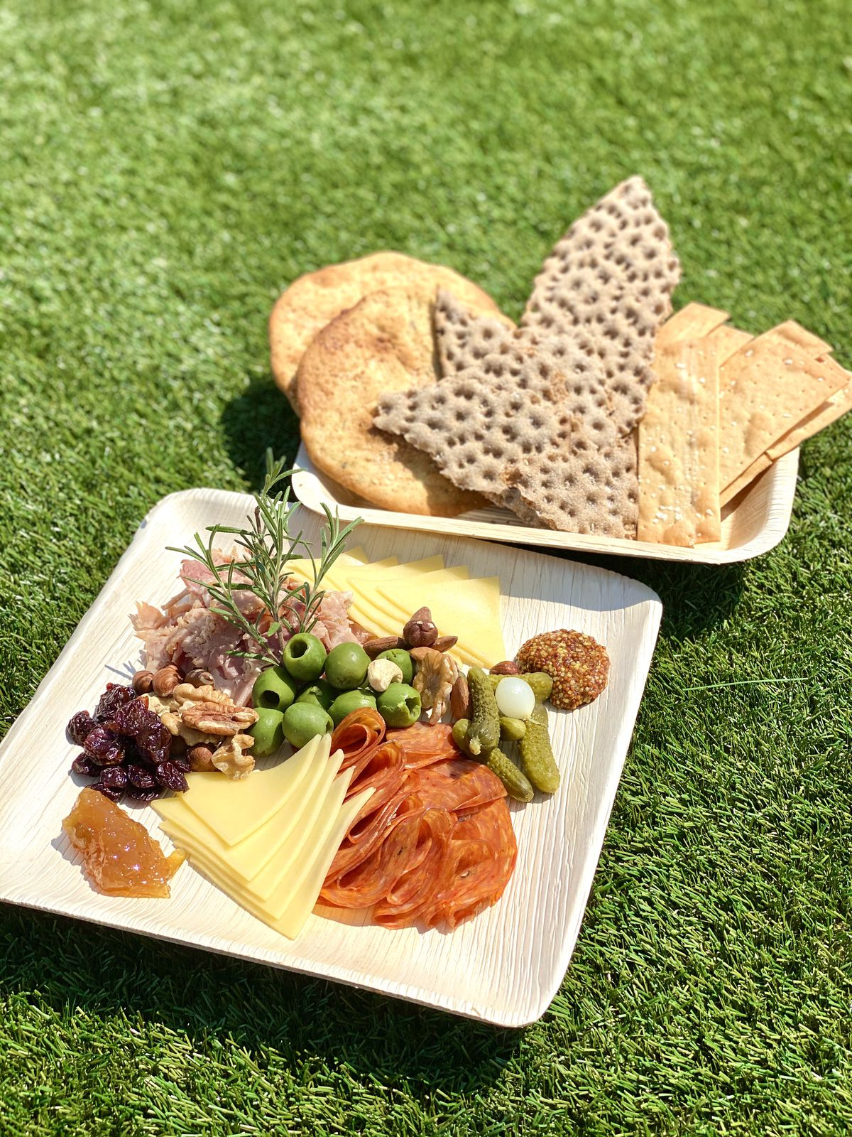 Cheese, charcuterie, jams, and crispy crackers at Hi-Lawn.