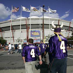 Minnesota Vikings' fans head into the Hubert H. Humphrey Metrodome before their NFL preseason football game against the Kansas City Chiefs Friday.