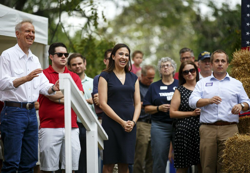 Erika Harold, center, a candidate for Illinois Attorney General, is introduced at the Governor's Day rally at the Illinois State Fair in Springfield, Ill. Wednesday, Aug. 16, 2017. Illinois Gov. Bruce Rauner is at left. (Rich Saal/The State Journal-Regist