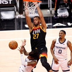 Utah Jazz center Rudy Gobert (27) dunks on Memphis Grizzlies guard Ja Morant (12) as the Utah Jazz and the Memphis Grizzlies play in game 5 at Vivint Arena in Salt Lake City on Wednesday, June 2, 2021. Utah won 126-110, Utah advances to the second round.