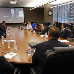 Those in attendance listen as U.S. Sen. Orrin Hatch speaks by video during a roundtable in Cottonwood Heights, Thursday, Nov. 20, 2014, concerning immigration reform.