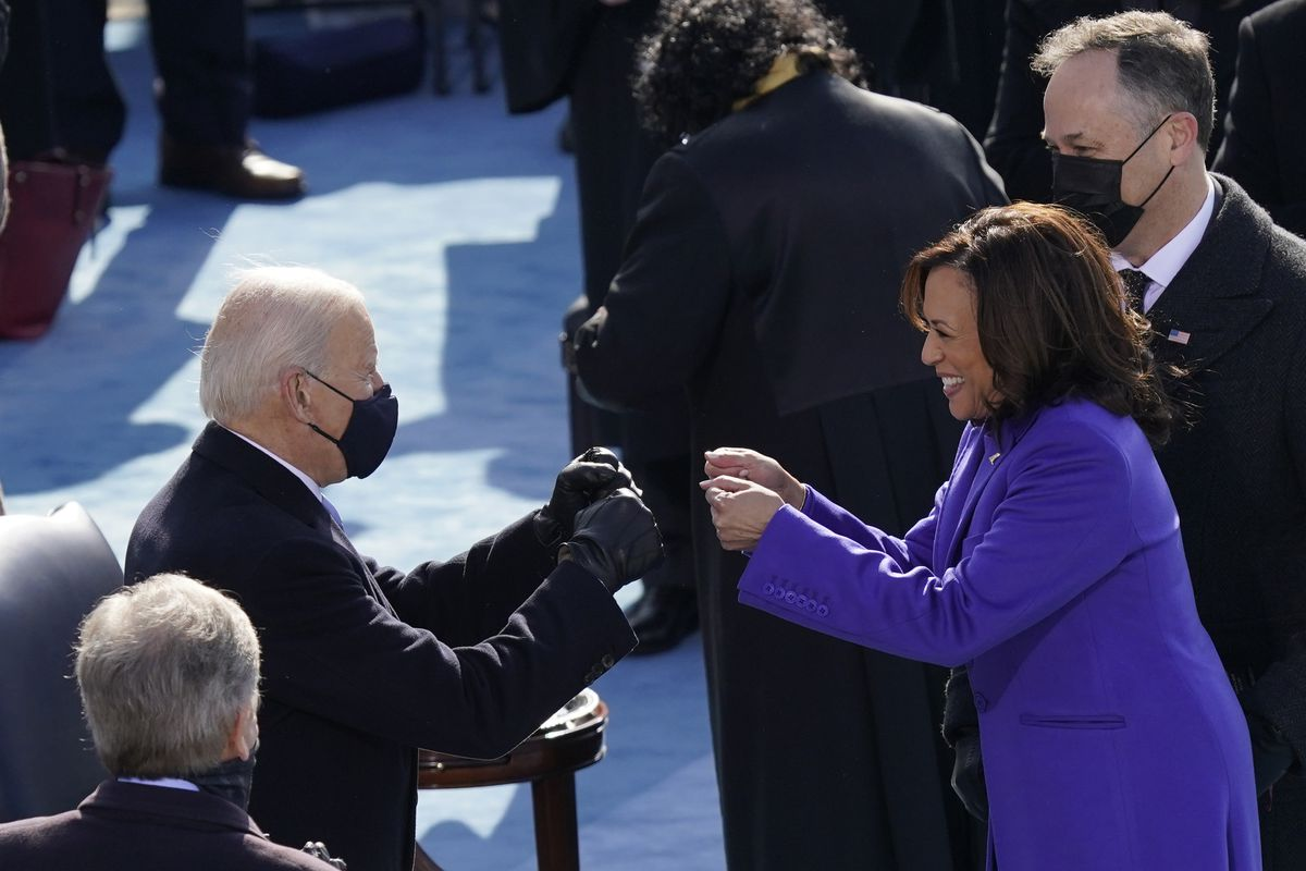 In this Jan. 20, 2021, file photo President-elect Joe Biden congratulates Vice President Kamala Harris after she was sworn in during the 59th Presidential Inauguration at the U.S. Capitol in Washington. Biden will mark his 100th day in office on Thursday, April 29.