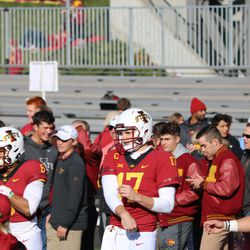Re-Al Mitchell (6), Kyle Kempt (17) and Brock Purdy (15) are all warming up. Notably, sophomore Zeb Noland is not pictured as he is taking a leave of absence from Cyclone Football.