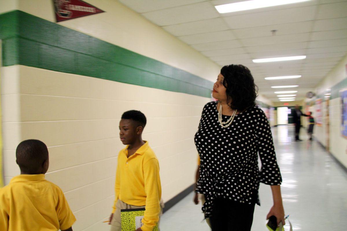 As a principal, Yolanda Dandridge said she walks almost 14,000 steps a day — double the national average.