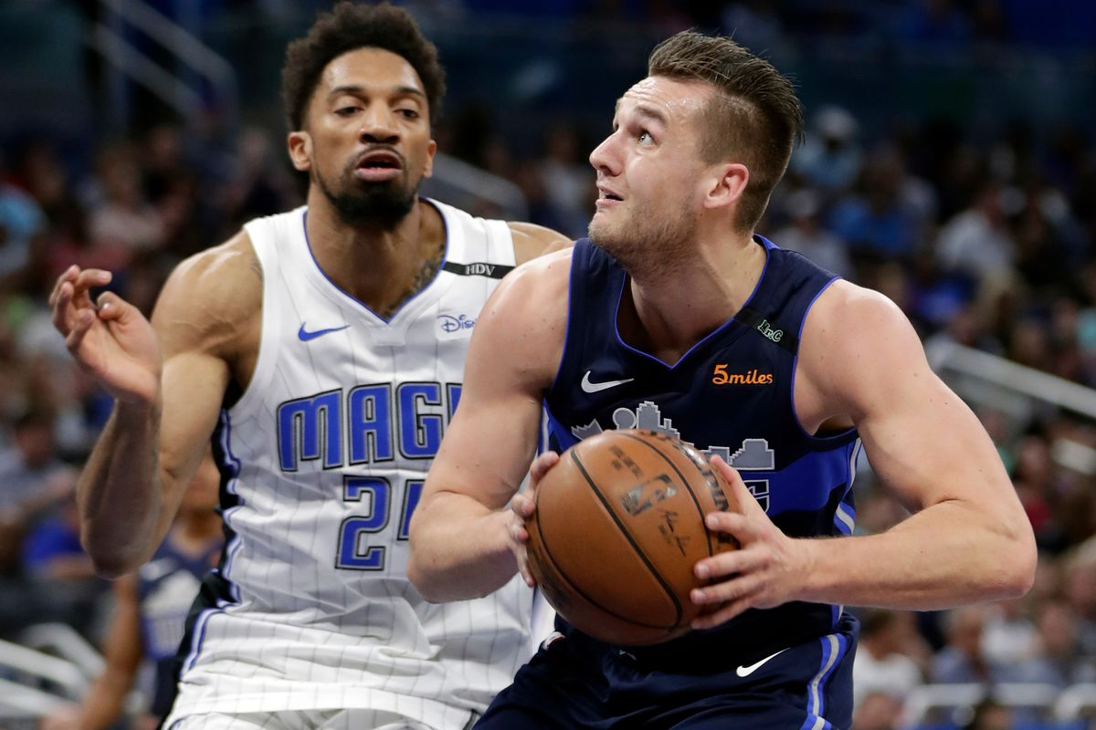 Dallas Mavericks' Kyle Collinsworth, right, goes to the basket past Orlando Magic's Khem Birch during the first half of an NBA basketball game, Wednesday, April 4, 2018, in Orlando, Fla. (AP Photo/John Raoux)