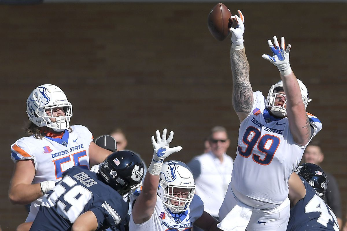 Boise State defensive tackle Scott Matlock (99) blocks the field goal attempt of Utah State place kicker Connor Coles (59).
