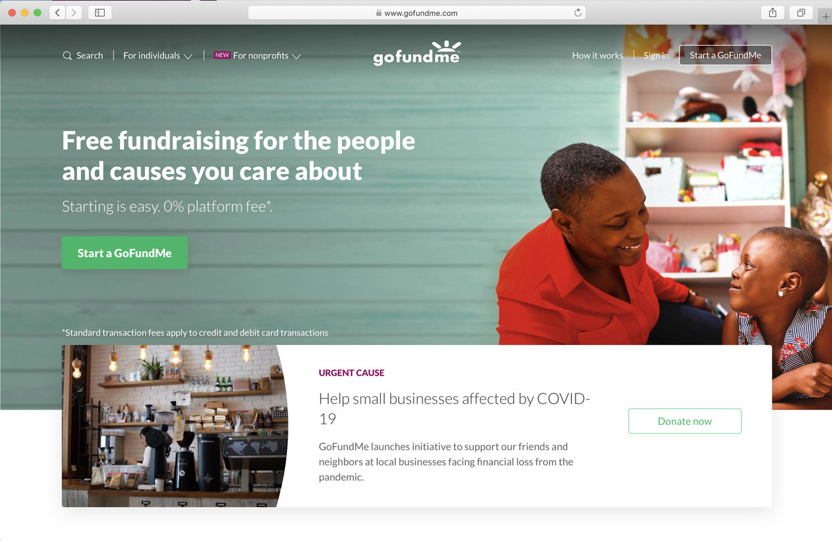 A screengrab of the GoFundMe homepage showing a woman and child.