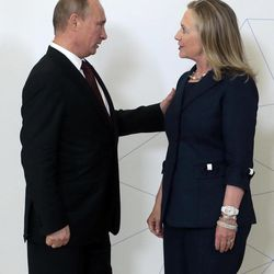 Russian President Vladimir Putin, left, meets U.S. Secretary of State Hillary Rodham Clinton on her arrival at the APEC summit in Vladivostok, Russia, Saturday, Sept. 8, 2012.