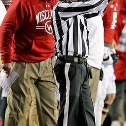 Paul Chryst disputes a procedure penalty.