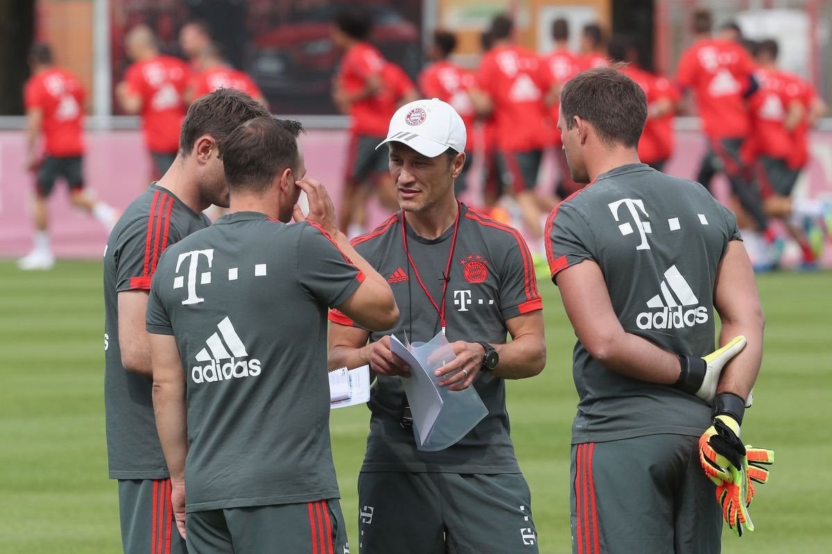 MUNICH, GERMANY - JULY 04: New team coach Niko Kovac (2ndR), his assistent coach and brother Robert Kovac (L), goalkeeper coach Toni Tapalovic (R) and physiotherapist Bernd Schosser of FC Bayern Muenchen chat during the team's first training session at the club's Saebener Strasse training court on July 4, 2018 in Munich, Germany.