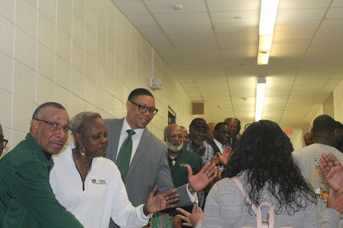 Members of 100 Black Men of Indianapolis, Crispus Attucks alumni, and IPS superintendent Lewis Ferebee greeted students as they entered the building on the first day of school.