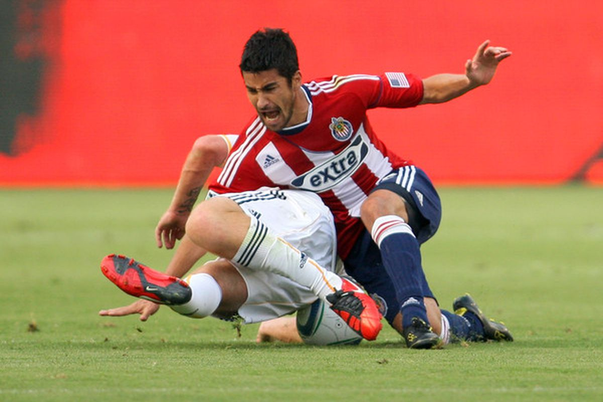 If he can stay healthy, midfielder Paulo Nagamura could play an important role for Sporting Kansas City in 2012.  (Photo by Victor Decolongon/Getty Images)
