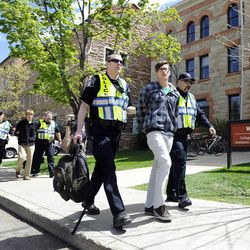 University of Colorado senior Jonathan Edwards, right, senior John Demopoulos, middle, and senior Gabriel Kuettel is arrested by Boulder County Sheriff deputies for trespassing on the Norlin Quad by going past the police tape on the University of Colorado campus in Boulder, Colo., on Friday, April 20, 2012. A block-long line of protesters marched onto the University of Colorado, testing the school's determination to push the annual April 20 marijuana celebration off campus.