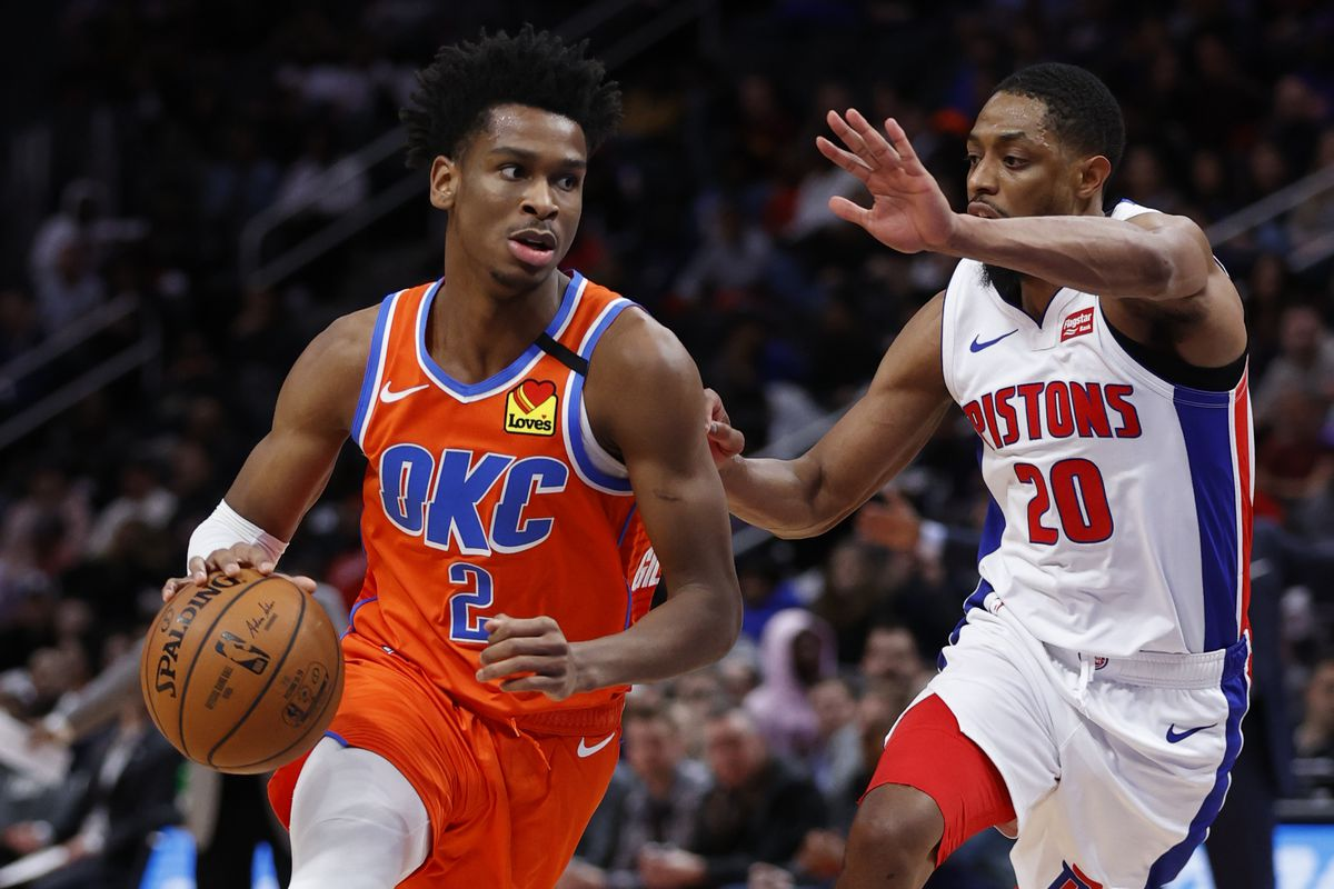 Oklahoma City Thunder guard Shai Gilgeous-Alexander dribbles defended by Detroit Pistons guard Brandon Knight in the first half at Little Caesars Arena.
