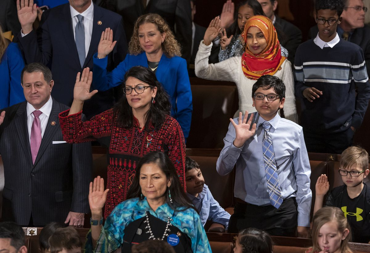 Tlaib proudly wore her thobe to her historic swearing-in as the first Palestinian American member of Congress, inspiring women around the world to tweet photos of themselves in their ancestral robes. (AP Photo/J. Scott Applewhite, File)