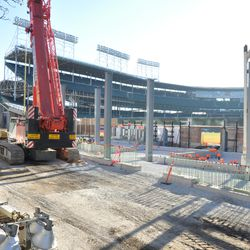 The new vertical steel columns in right center field along Sheffield -