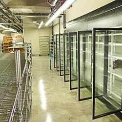 """Second floor retail area with coolers. Wine sales in the back. Custom wooden shelves. [<a href=""""http://www.flickr.com/photos/garyrwise"""">Gary R Wise</a>]"""