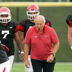 John Pease, defensive line coach, watches players execute drills during a Utah football practice at the University of Utah Aug. 19,  2010.