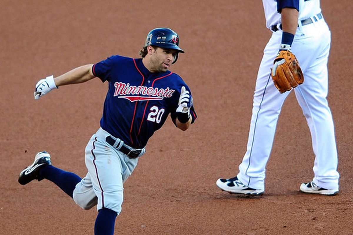 May 16, 2012; Detroit, MI, USA; Minnesota Twins shortstop Brian Dozier (20) rounds third base to score a run in the first inning against the Detroit Tigers at Comerica Park. Mandatory Credit: Andrew Weber-US PRESSWIRE