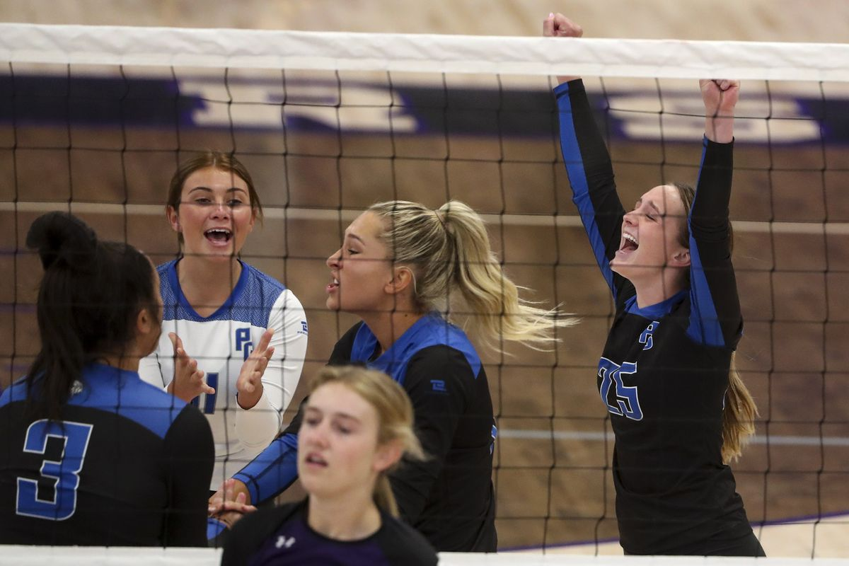 Pleasant Grove's Sadie Henrie, right, celebrates a point with her teammates during volleyball match at Lehi High School on Tuesday, Aug. 18, 2020.
