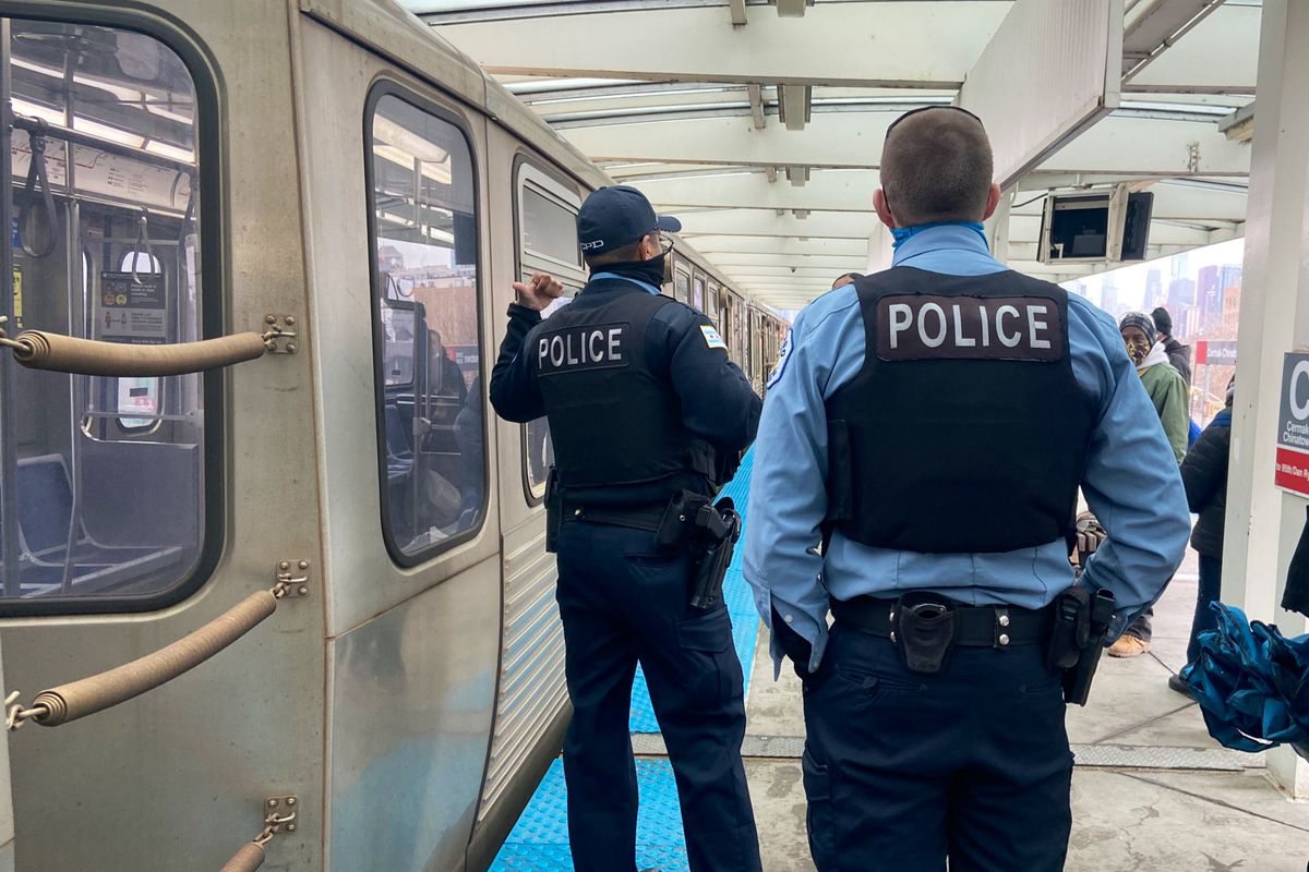 Chicago police investigate an aggravated battery on a train at the Cermak-Chinatown station, March 16, 2021.