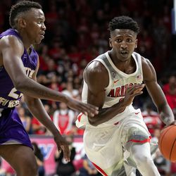 Arizona's Dylan Smith, right, pushes the ball up the court during the Arizona-Western New Mexico University game in McKale Center on October 30 2018 in Tucson, Ariz.