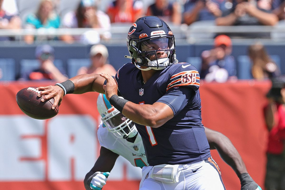 Bears quarterback Justin Fields throws against the Dolphins in a preseason game Saturday.