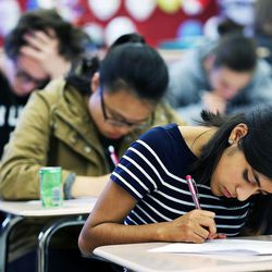 Student Alessandra Huamani, front, takes a test along with other students in Syd Lott's IB Economics class at Skyline High School in Salt Lake City, Tuesday, Oct. 20, 2015.