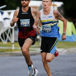 Jared Ward, left, gets passed by Rory Linkletter in the Deseret News 10K in Salt Lake City on Friday, July 23, 2021.