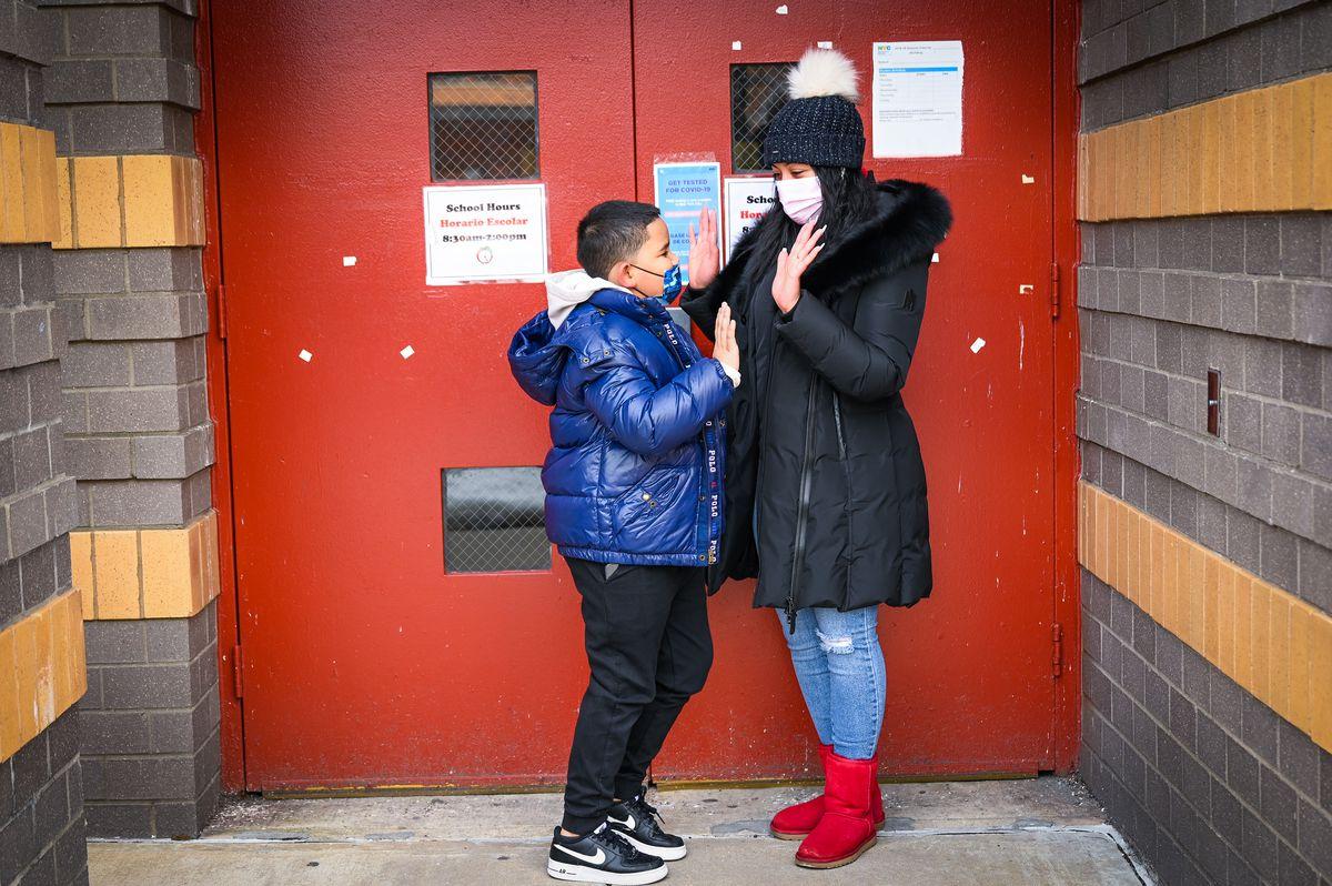 Yanelsy Aguavivas and her son Jariel Acosta, 8, outside PS 8 in the Washington Heights neighborhood of Manhattan.