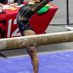 Utah's Alexia Burch performs on the beam as Utah and UCLA compete in a gymnastics meet at the Huntsman Center in Salt Lake City on Friday, Feb. 19, 2021.