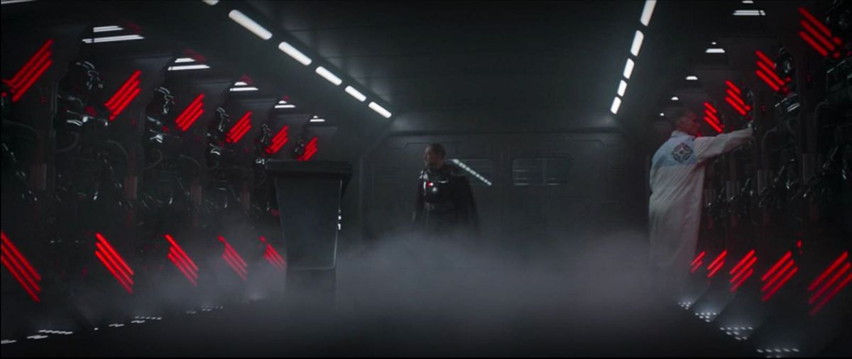Several squads of ... something on an Imperial light cruiser. Red lights ring them, while Moff Gideon looks on.