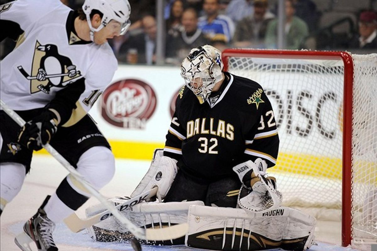 Feb 29, 2012; Dallas, TX, USA; Dallas Stars goalie Kari Lehtonen (32) makes a save on Pittsburgh Penguins left wing James Neal (18) during the first period at the American Airlines Center. Mandatory Credit: Jerome Miron-US PRESSWIRE