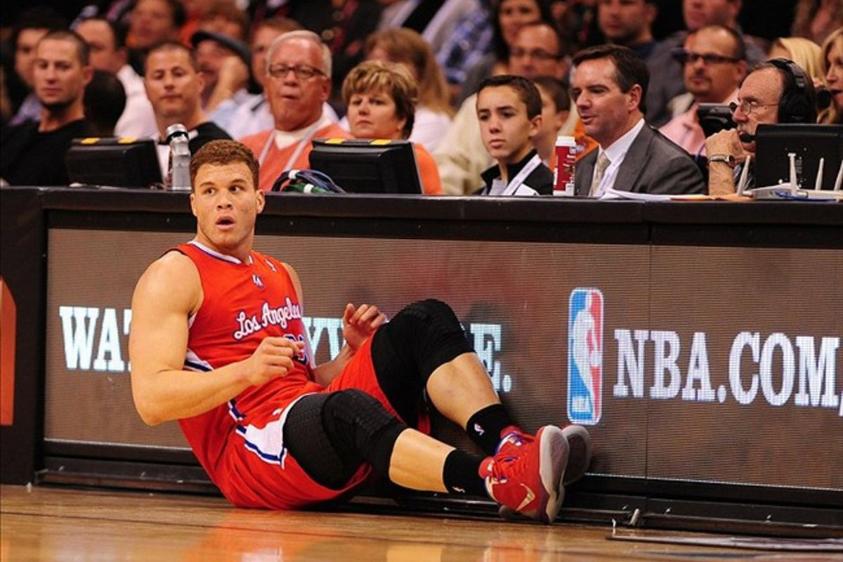 Mar. 2, 2012; Phoenix, AZ, USA; Los Angeles Clippers forward Blake Griffin falls to the ground in the first half against the Phoenix Suns at the US Airways Center. Mandatory Credit: Mark J. Rebilas-US PRESSWIRE