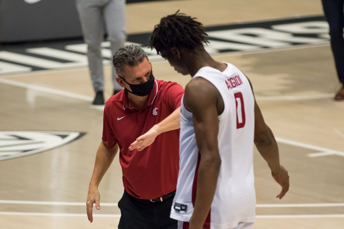 PULLMAN, WA - DECEMBER 18: Washington State head coach Kyle Smith celebrates with center Efe Abogidi (0) prior to a non-conference matchup between the Montana State Bobcats and the Washington State Cougars on December 18, 2020, at Beasley Coliseum in Pullman, WA.