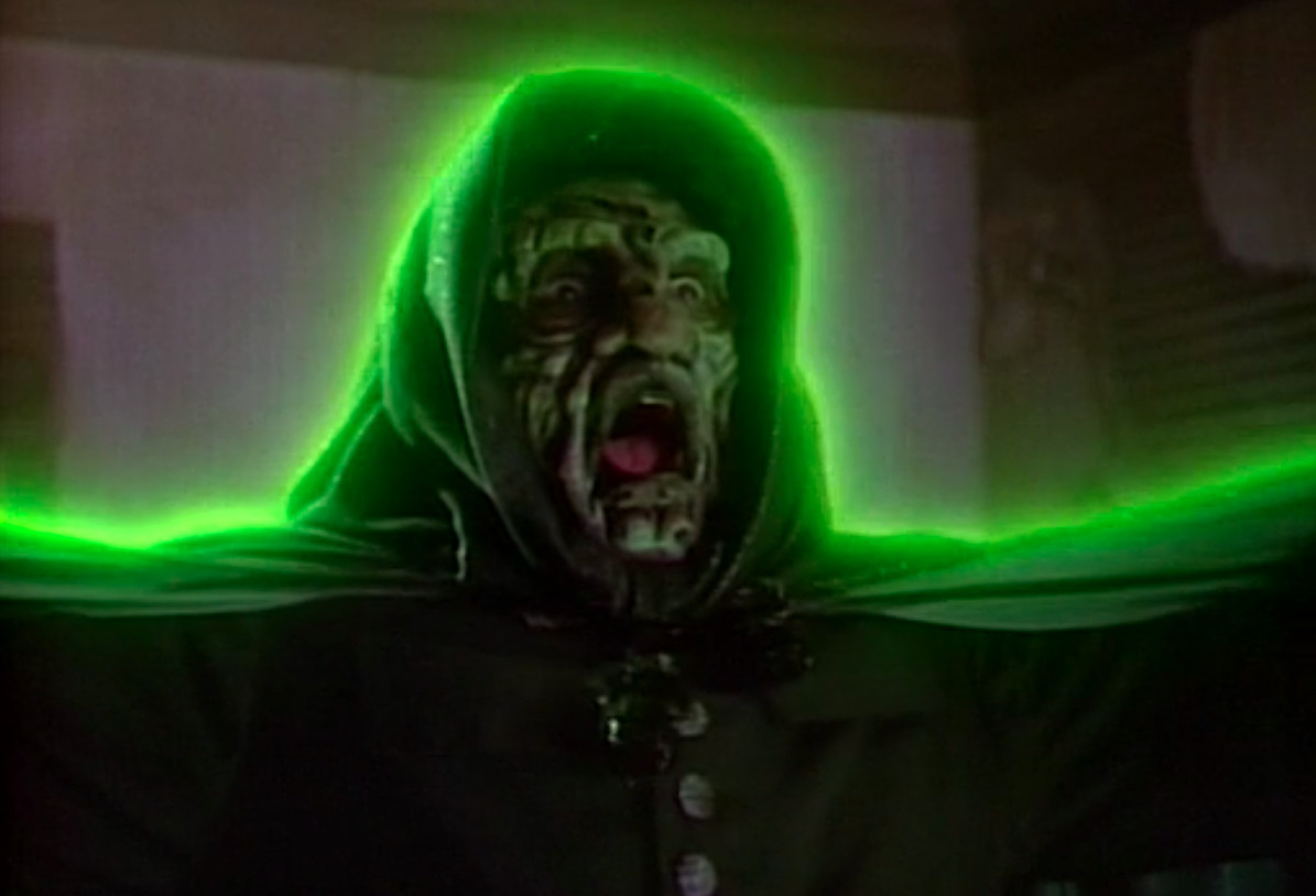 The titular ghost Mr. Boogedy, outlined by a glowing green neon penumbra