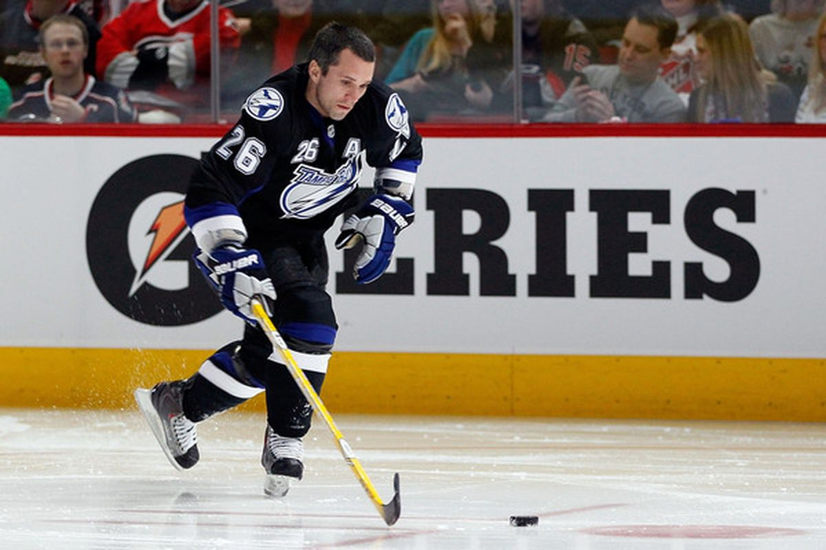 Martin St. Louis, shown here during the 2011 NHL All-Star game festivities in Raleigh, North Carolina, should be a serious part of the 2011 NHL Hart Trophy discussion.  (Photo by Kevin C. Cox/Getty Images)