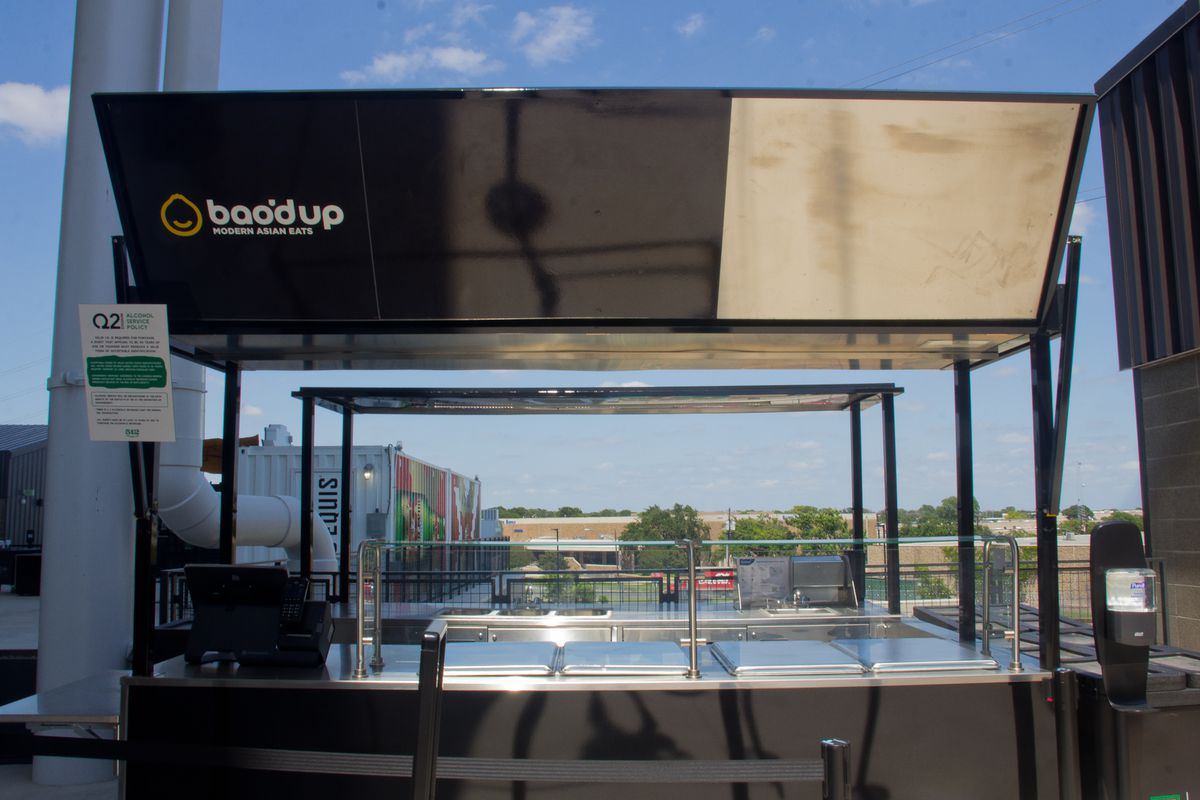 """A black stadium kiosk with a sign that reads """"Bao'd Up"""""""