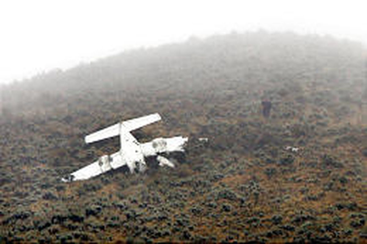 Low clouds hang over spot where small plane crashed in the mountainside near Draper's South Mountain.