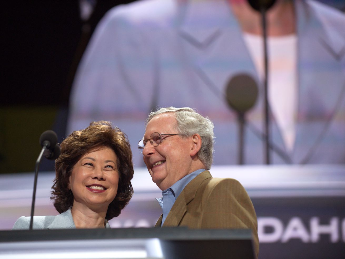 Mitch McConnell and his wife, Elaine Chao, check the podium the day before the start of the Republican National Convention at the Quicken Loans Arena in Cleveland on July 17, 2016.