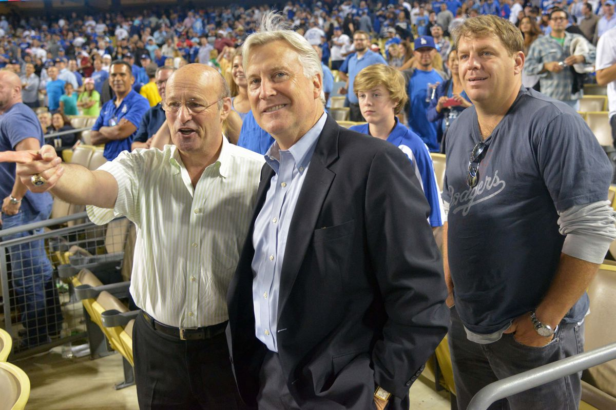 Dodgers CEO Stan Kasten, chairman Mark Walter, and partner Todd Boehly watch a game at Dodger Stadium.