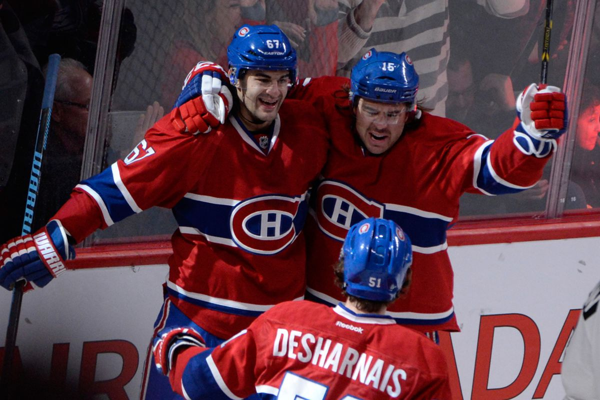 Nov 15, 2014; Montreal, Quebec, CAN; Montreal Canadiens forward Pierre-Alexandre Parenteau (15) reacts with teammates Max Pacioretty (67) and David Desharnais (51)