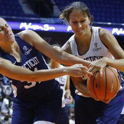 Carla Berube and Svetlana Abrosimova fight for a loose ball.