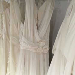 Gown with rose detail, $2,090 (was $4,180)