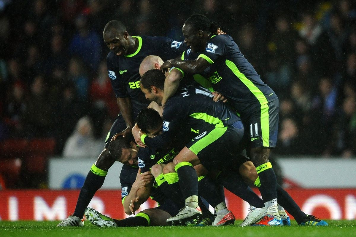 Antolin Alcaraz of Wigan Athletic is mobbed by his team mates aftyer scoring the winning goal during the Barclays Premier League match between Blackburn Rovers and Wigan Athletic at Ewood Park.