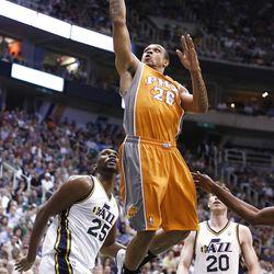 Phoenix Suns guard Shannon Brown (26) drives for a shot between Utah Jazz center Al Jefferson (25) and guard Gordon Hayward (20) during the first half of an NBA basketball game, Tuesday, April 24, 2012, in Salt Lake City. (AP Photo/Jim Urquhart)